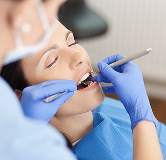 Relaxed woman receiving dental care