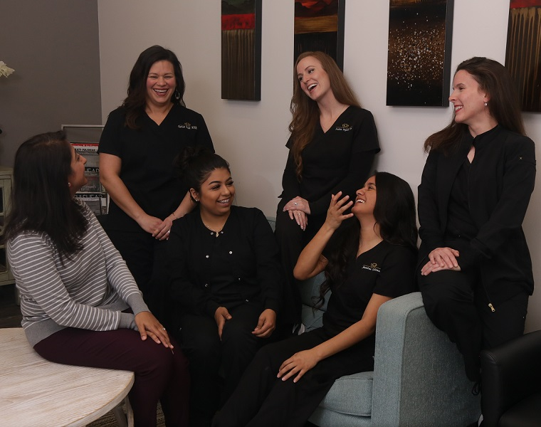The Fulshear Dental team laughing togehter